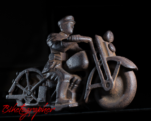 Cast iron motorcycle toy.  Age unknown.
